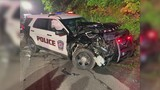 Cars heavily damaged in crash, police officer and driver get out alive